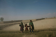 Afghan children in Ghazni wave at a convoy of the 2-87 Unit of 3rd Brigade Tenth Mountain Division, 1-102 Infantry. The US troops began conducting Operation Mountain Fury since Sept. 12, 2006, and the platoons from Ghazni FOB had been on a mission, killing at least 17 Taliban fighters in Andar district. Now during the times of Ramadan, the Holy Month for Muslims, the Taliban activities have been dwindled down in the region as units from 102nd Inf. conduct mild operations of Mt. Fury such as village assessments and humanitarian drop-offs, the US troops are still exposed to a danger of hidden combat by the remaining Taliban fighters in this area. Members of 2-87 Unit, comprised with 41 personnel from all over the US aged from 19 to 35. The 102nd Inf., dated back to the Civil War time, from New Haven, Conn., had arrived in Ghazni in April this year and will stay here for one year until it is replaced by another inf. of reservists next April.