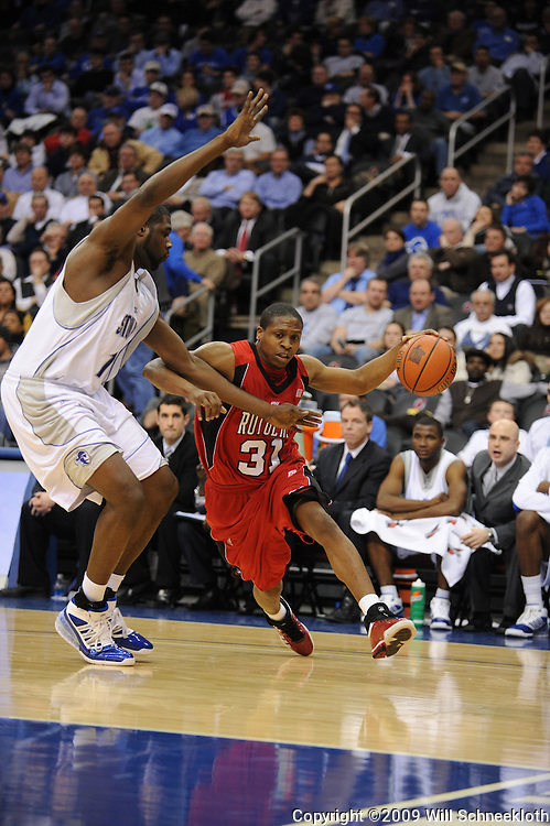 Jan 29, 2009; Newark, NJ, USA;  Rutgers guard Mike Coburn (31) drives to the net against Seton Hall forward Mike Davis (13) during the first half of Seton Hall's 70-67 victory at the Prudential Center.