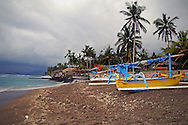 Indonesia, Bali. Outriggers on the beach in Candidasa early in the morning.