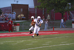 10 Sep 2005<br /> <br /> Jordan Bontrager heads back as a Redbird puts on the breaks to follow.<br /> <br /> Illinois State University V Drake.  Hancock Stadium, Illinois State University, Normal IL