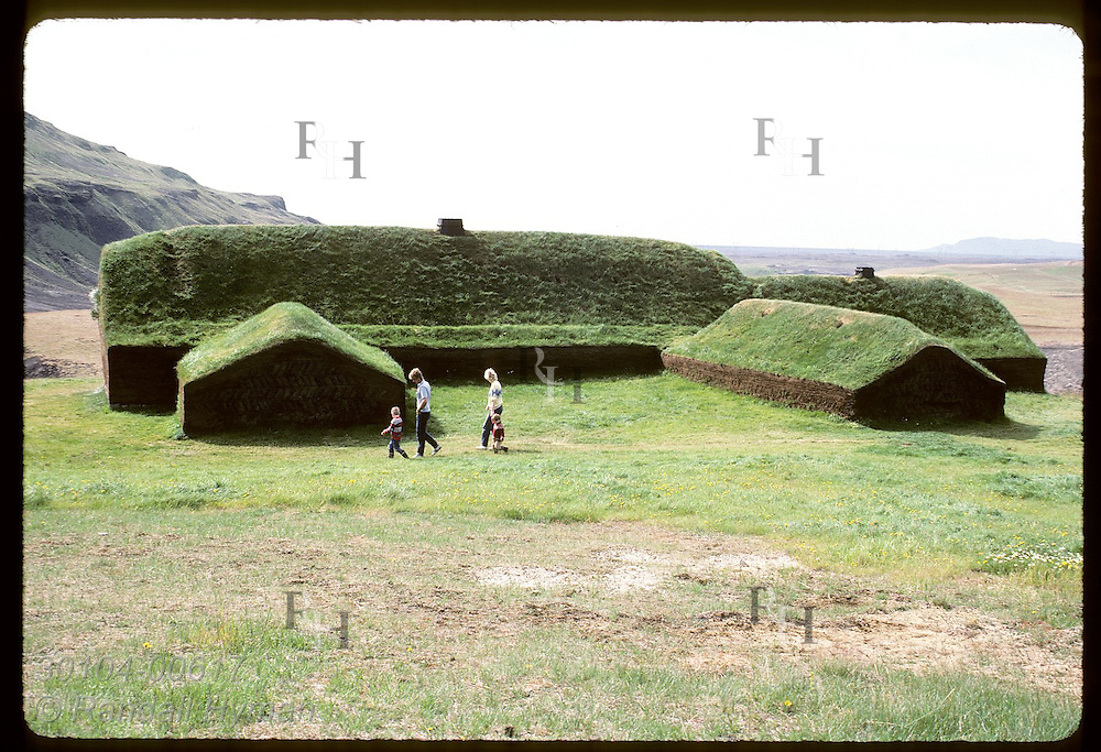 Visitors walk around back of reconstructed Viking farm at Stong; ruins dated from 11th century Iceland