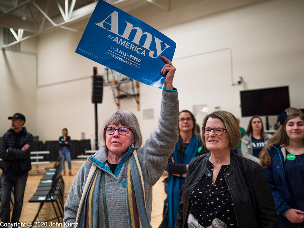 01 MARCH 2020 - ST. LOUIS PARK, MINNESOTA: Supporters of Sen. Amy Klobuchar after news that Klobuchar cancelled her campaign rally when it was disrupted by Black Lives Matter. Dozens of Black Lives Matter (BLM) protesters disrupted Sen. Amy Klobuchar's last presidential election rally in Minnesota before Super Tuesday. Almost 500 Klobuchar supporters came to hear Sen. Klobuchar, when the BLM protesters marched into the hall and took control of the stage. Klobuchar cancelled the event about an hour after the BLM protesters entered the hall. The protesters targeted Klobuchar because while she was the Hennepin County Attorney, she oversaw the conviction of Myon Burrell, a black teenager accused and convicted of murder. Evidence has come to light since his conviction that suggests he was wrongly convicted. His conviction has become a flashpoint in Minnesota politics.        PHOTO BY JACK KURTZ