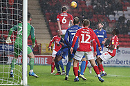 Charlton Athletic defender Jason Pearce (6) clearing the ball during the EFL Sky Bet League 1 match between Charlton Athletic and AFC Wimbledon at The Valley, London, England on 15 December 2018.