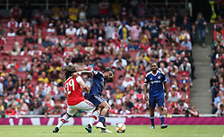 Matteo Guendouzi of Arsenal and Memphis Depay of Lyon tussle for the ball - Mandatory by-line: Arron Gent/JMP - 28/07/2019 - FOOTBALL - Emirates Stadium - London, England - Arsenal v Olympique Lyonnais - Emirates Cup