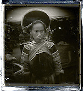 Portrait of a Hmong wearing traditional clothes and headgear.