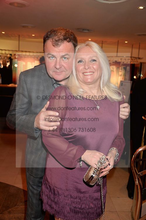 PAUL ROSS and his wife JACKIE at the Costa Book Awards 2013 held at Quaglino's, 16 Bury Street, London on 28th January 2014.