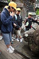 Japanese School Kids on Excursion at Toshogu Shrine - built in 1617 as the mausoleum of the Tokugawa Ieyasu. The main shrine buildings were built by the third shogun, Tokugawa Iemitsu in 1636. Building of the Toshogu represented the climax of the Gongen zukuri style which characterizes Japanese shrine architecture. Skills of the highest level available at the time were applied to the structures.