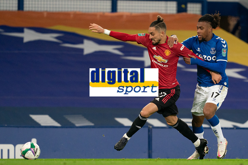 Football - 2020 / 2021 League Cup - Quarter-Finbal - Everton vs Manchester United - Goodison Park<br /> <br /> <br /> Manchester United's Alex Telles battles with Everton Alex Iwobi<br /> <br /> COLORSPORT/TERRY DONNELLY