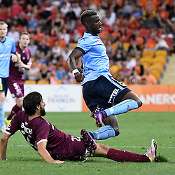 BRISBANE, AUSTRALIA - NOVEMBER 19: Bernie Ibini of Sydney is tackled by Thomas Broich of the Roar during the round 7 Hyundai A-League match between the Brisbane Roar and Sydney FC at Suncorp Stadium on November 19, 2016 in Brisbane, Australia. (Photo by Patrick Kearney/Brisbane Roar)