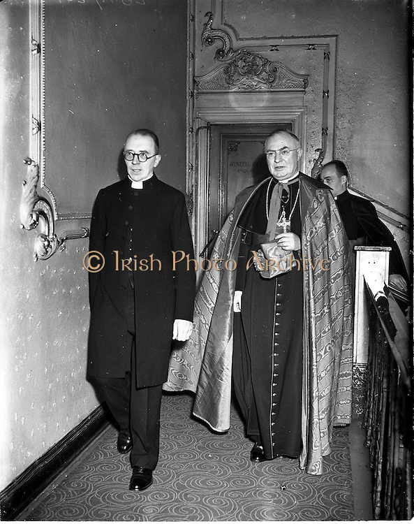 """21/12/1952<br /> 12/21/1952<br /> 21 December 1952<br /> Most Rev. Dr. Gerald O'Hara, (right) Papal Nuncio to Ireland with Fr. Thackcherry arriving at the Capitol Theatre Dublin for Our Lady's Choral Society and the Radio Eireann Symphony Orchestra's production of Handel's """"Messiah""""."""
