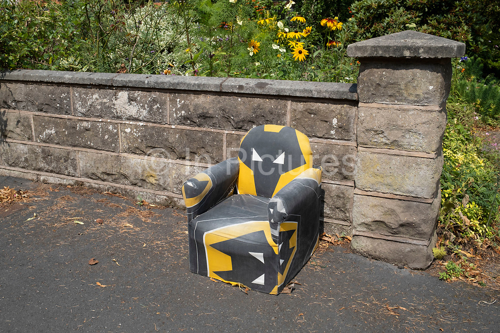 A childrens small Wolverhampton Wanderers F.C. aka Wolves chair put out on the street form someone else to take on 10th August 2020 in Birmingham, United Kingdom. Wolverhampton Wanderers Football Club, commonly known as Wolves, is a professional association football club based in Wolverhampton, West Midlands, England.