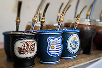 Close up of mate cups with Uruguay flag. Mate is a traditional drink very similar to tea in Argentina, Uruguay, Paraguay and some parts of Brazil.