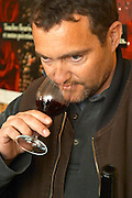 Yves Cuilleron, owner and winemaker. Tasting a glass of wine. Domaine Yves Cuilleron, Chavanay, Ampuis, Rhone, France, Europe