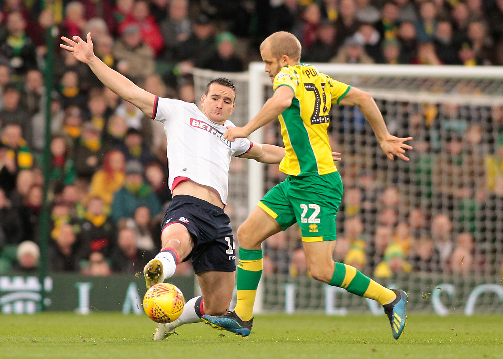 Bolton Wanderers' Jack Hobbs tackles Norwich City's Teemu Pukki<br /> <br /> Photographer David Shipman/CameraSport<br /> <br /> The EFL Sky Bet Championship - Norwich City v Bolton Wanderers - Saturday 8th December 2018 - Carrow Road - Norwich<br /> <br /> World Copyright © 2018 CameraSport. All rights reserved. 43 Linden Ave. Countesthorpe. Leicester. England. LE8 5PG - Tel: +44 (0) 116 277 4147 - admin@camerasport.com - www.camerasport.com
