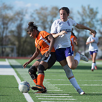 092514      Cayla Nimmo<br /> <br /> Gallup Bengal SherRae Fox (22) keeps possession of the ball from Miyamura Patriot Gabby Thornton (6) during the game held at the Public School Stadium in Gallup Thursday.