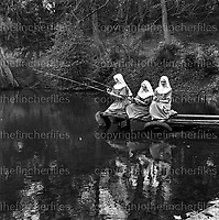 Franciscan nuns from the Ladywell Convent near Godalming, Surrey,England seen fishing on Busbridge Lakes. Photograph by Terry Fincher