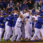 Kansas City Royals first baseman Eric Hosmer celebrated with the team after his sacrifice fly in the 14th inning to win Game 1 of the 2015 World Series over the New York Mets on October 28, 2015 at Kauffman Stadium in Kansas City, Mo.