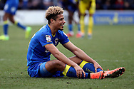 AFC Wimbledon striker Lyle Taylor (33) sat on the floor laughin during the EFL Sky Bet League 1 match between AFC Wimbledon and Oxford United at the Cherry Red Records Stadium, Kingston, England on 10 March 2018. Picture by Matthew Redman.