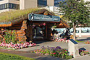 The sod-roofed Visit Anchorage Log Cabin Visitor Information Center at Peratrovich Park in downtown Anchorage, Alaska.