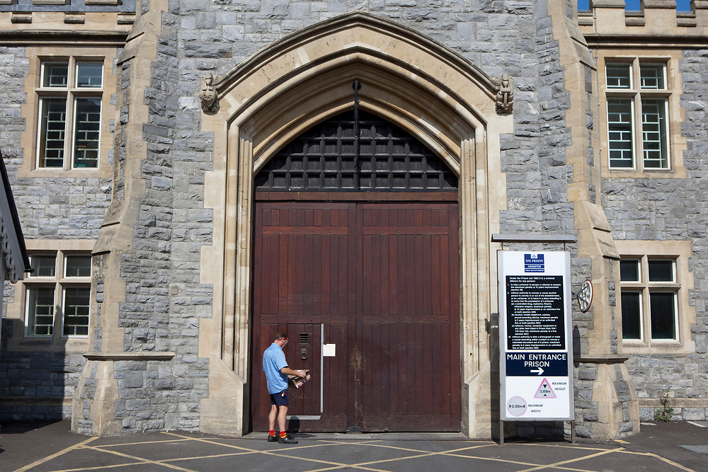 A Royal Mail postman arrive with a parcel at the main gate of HMP Kingston, Portsmouth
