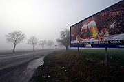 Mezirici/Tschechische Republik, CZE, 11.12.06: Bier Werbung in einer Süd-Böhmischen Landschaft im Nebel in der Nähe des Dorfes Mezirici.<br /> <br /> Mezirici/Czech Republic, CZE, 11.12.06: South Bohemian landscape close to the village Mezirici in foggy weather with a beer commercial on a billboard.