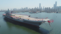 April 26, 2017  - Dalian, China - China's second aircraft carrier is transferred from dry dock into the water at a launch ceremony in Dalian shipyard of the China Shipbuilding Industry Corp. The new carrier, the first domestically-built one, came after the Liaoning, a refitted former Soviet Union-made carrier that was put into commission in the Navy of the Chinese People's Liberation Army in 2012.  (Credit Image: © Li Gang/Xinhua via ZUMA Wire)