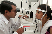 India. Orissa State. Dr Shiva, ophthalmologist, checks the eyesight of a patient.