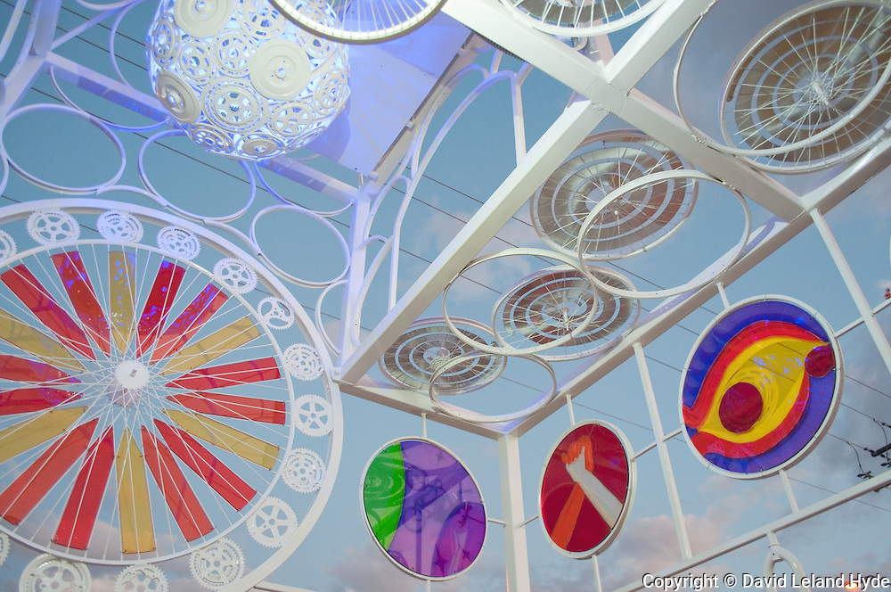 """""""Bicycle Church"""" Made of Bicycle Parts, stained-glass windows, El Barrio, Tucson Arizona, postmodern art, urban art, abstract photography, open sky, power pole, street light, bicycle wheels, bicycle sprockets"""
