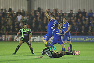 AFC Wimbledon defender & captain Barry Fuller (2) is tackled during the The Emirates FA Cup 1st Round Replay match between AFC Wimbledon and Bury at the Cherry Red Records Stadium, Kingston, England on 15 November 2016. Photo by Stuart Butcher.
