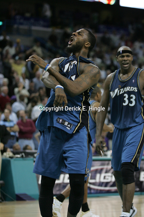 DeShawn Stevenson #2 celebrates his buzzer beater, game winning shot with teammatee Brendan Haywood #33 against the New Orleans Hornets that gave the Washington Wizards a 95-92 win on February 25, 2008 at the New Orleans Arena in New Orleans, Louisiana.
