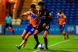 Tyrese Sinclair of Mansfield Town puts pressure on Jamie Soule of Lincoln City - Mandatory by-line: Ryan Crockett/JMP - 06/10/2020 - FOOTBALL - One Call Stadium - Mansfield, England - Mansfield Town v Lincoln City - Leasing.com Trophy