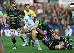 Saracens Marcelo Bosch is tackled by during the Champions Cup match at Franklin's Gardens, Northampton.