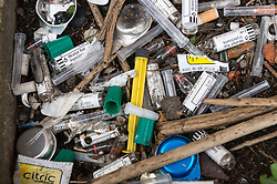 Discarded hypodermic needles used by heroin addicts