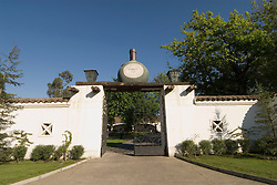 Chile Wine Country: Gate with wine bottle motif at Undurraga winery near Santiago..Photo #: ch404-33869.Photo copyright Lee Foster, 510-549-2202, www.fostertravel.com, lee@fostertravel.com.