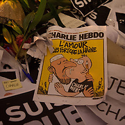 A front page from the Charlie Hebdo magazine states that love is stronger tha hate. Londoners show their solidarity with the 12 people killed in an attack on the magazine Charlie Hebdo in Paris and their revulsion of the attack on freedom of speech at a vigil in Trafalgar Square. Three attackers killed ten journalist working for Charlie Hebdo and two police officers, the worst terrorist attack in Paris, France in 50 years.