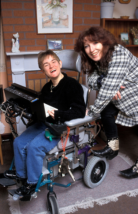 Disabled woman in motorised wheelchair,