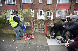 © Licensed to London News Pictures. 11/04/2018. London, UK. A man who gave his name as Iain Gordon kicks some bouquets along the pavement in front of photographers after removing all the floral tributes from near the house of Richard Osborn-Brooks. Henry Vincent was killed as he burgled the home of 78 year old Richard Osborn-Brooks. Mr Osborn-Brooks was arrested for murder but later released without charge. Friends and family of Henry Vincent have had floral tributes they placed near the scene repeatedly torn down by locals. Photo credit: Peter Macdiarmid/LNP