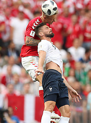 MOSCOW, June 26, 2018  Olivier Giroud of France competes for a header with Simon Kjaer (top) of Denmark during the 2018 FIFA World Cup Group C match between Denmark and France in Moscow, Russia, June 26, 2018. (Credit Image: © Xu Zijian/Xinhua via ZUMA Wire)