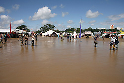 © Licensed to London News Pictures. 24/06/2012. Somerset, UK. Large parts of the site were covered in mud. Festival goers enjoy the mud and the sunshine at The Sunrise Festival held at Bruton In Somerset today 24 June 2012. Photo credit : Jason Bryant/LNP