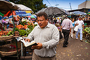 08 JANUARY 2007 - MANAGUA, NICARAGUA:  An evangelical street preacher works in Mercado Oriental, the main market that serves Managua, Nicaragua. The market encompasses dozens of square blocks and is the largest market in Central America.  Photo by Jack Kurtz