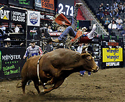 Allison De Souza of Brazil rides Lil 2 Train during a Professional Bull Riders competition at the Sprint Center, in Kansas City, Mo., Sunday, March 24, 2019. (AP Photo/Colin E. Braley)