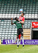 Plymouth Argyle Forward Panutche Camará (28) battles in the air with Sunderland player while being poke in the face during the EFL Sky Bet League 1 match between Plymouth Argyle and Sunderland at Home Park, Plymouth, England on 1 May 2021.