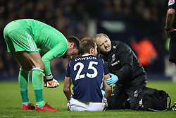 West Bromwich Albion's Craig Dawson (centre) is treated by physio Richie Rawlins as West Bromwich Albion goalkeeper Ben Foster (left) looks on during the Premier League match at The Hawthorns, West Bromwich.