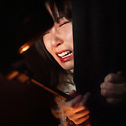 Nai Nai, a 23-year-old live-streamer in Shanghai, China, screams to her camera during a visit to a haunted house.Nai Nai's fans are mostly Chinese men between 15 and 30 years old who post messages and virtual gifts, visible to everyone logged on to her chatroom. China's livestreaming industry reached 425 million subscribers in 2018 out of a current total internet user base of more than 829 million, according to government statistics cited in Chinese state media. Livestream hosting is an increasingly popular career choice, especially for young Chinese women like Nai Nai.