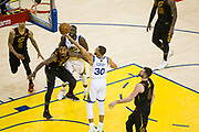Golden State Warriors guard Stephen Curry (30) scores a basket against the Cleveland Cavaliers during Game 1 of the NBA Finals at Oracle Arena in Oakland, Calif., on May 31, 2018. (Stan Olszewski/Special to S.F. Examiner)