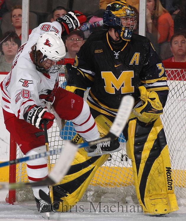 2/12/05  Omaha, NE University of Nebraska at Omaha's Kaleb Betts. runs into Michigan goalie Al Montoya. (photo by Chris Machian/ Prarie Pixel Group)