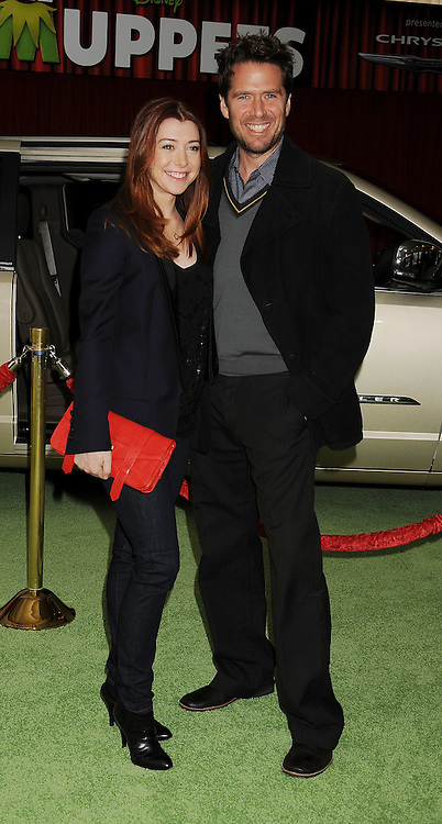 """HOLLYWOOD, {CA} - NOVEMBER 12: Alyson Hannigan and Alexis Denisof attend """"The Muppet"""" Los Angeles Premiere at the El Capitan Theatre on November 12, 2011 in Hollywood, California."""
