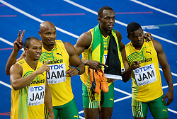Michael Frater, Asafa Powell, Usain Bolt  and Steve Mullings of Jamaica celebrate winning the gold medal in the mens 4x100 Metres Relay Final with mascot Berlino during day eight of the 12th IAAF World Athletics Championships at the Olympic Stadium on August 22, 2009 in Berlin, Germany. (Photo by Vid Ponikvar / Sportida)