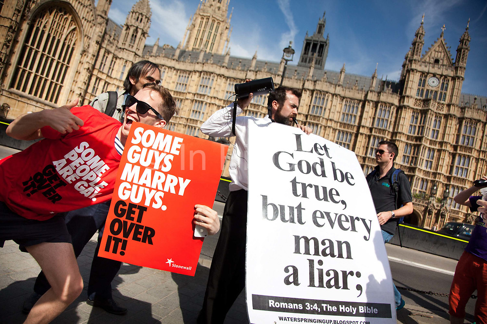 A few Christians opponents of the bill made themselves hear using a speaker and posters. They threatened the crowd with God's ponishment for being sinners. The moment when it is announced that the Same Sex Marriage bill had been passed. London Gay Chorus and supporters of the bill celebrate outside the House of Lords. The campaign for the bill has lasted decades. Summary of the Marriage (Same Sex Couples) Bill 2012-13 to 2013-14<br /> A Bill to make provision for the marriage of same sex couples in England and Wales, about gender change by married persons and civil partners, about consular functions in relation to marriage, for the marriage of armed forces personnel overseas, and for connected purposes.