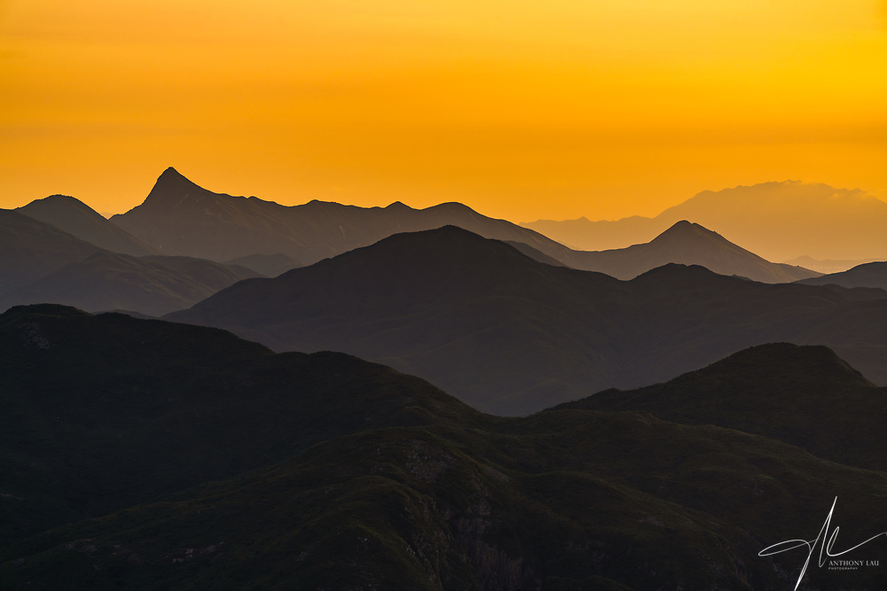 The amazing mountain lines over Clear Water Bay of Hong Kong, captured when the first line of golden colour illuminated the sky.